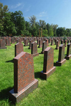 Obelisks and the bell at the Military Memorial of the Preobrazhenskoye cemetery Stock Photo - 12512554
