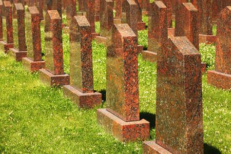 Rows of obelisks of red granite at the military memorial. Stock Photo - 12512647