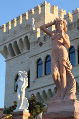 Two ancient statues on columns in fron of parade included in  palace Stock Photo - 12512308
