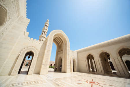 Oman: beautiful architecture inside Grand Mosque in Oman. arcs, tower. Editorial