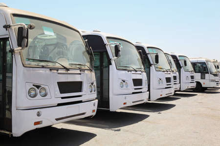 some: QUABOOS PORT, MUSCAT - APRIL, 13: row of buses waiting on bus station near port benefit April 13, 2010 in Muscat