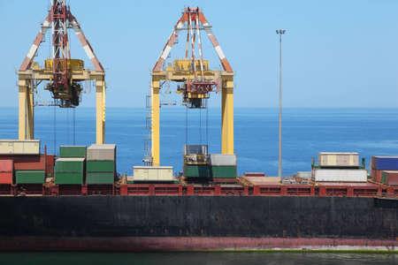 big merchant ship in port. many big cargos on board of ship. Stock Photo - 12512346