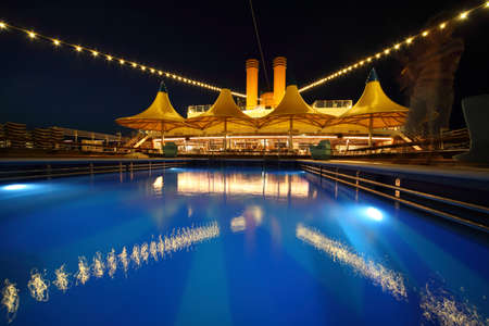 illuminated deck of ship at evening. swimming pool in deck of ship Stock Photo - 12512302