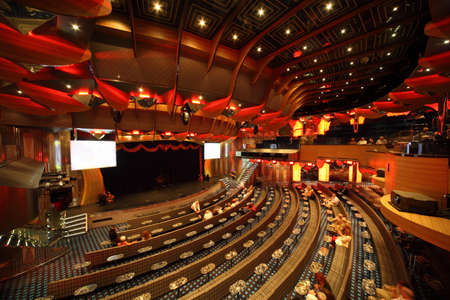 PERSIAN GULF - APRIL 14: big illuminated hall, scene, tables, people in Costa Deliziosa - the newest Costa cruise ship, 14 April 2010 in Persian Gulf. Costa Cruises - bigest cruise company in Europe. Stock Photo - 12512527
