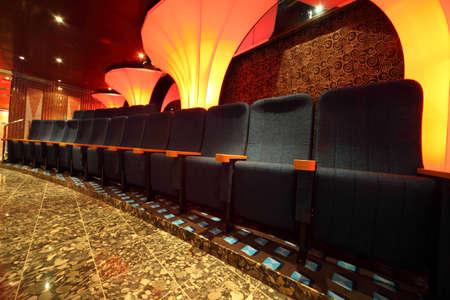 illuminated hall inside of ship. row of comfortable seats. wide angle. Stock Photo - 12512451