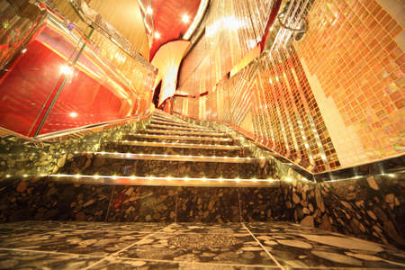 PERSIAN GULF - APRIL 14: big stairs inside big illuminated hall of Costa Deliziosa - the newest Costa cruise ship, 14 April 2010 in Persian Gulf. Costa Cruises - bigest cruise company in Europe.