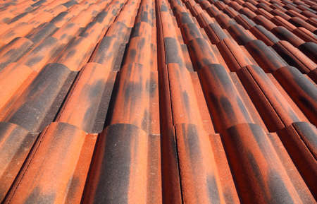 mandatoriccio: Old terracotta tile roof, detailed structure view along the tiles