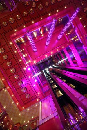 PERSIAN GULF - APRIL 14: lift shaft inside illuminated hall of Costa Deliziosa - the newest Costa cruise ship, 14 April 2010 in Persian Gulf. Costa Cruises - bigest cruise company in Europe. Stock Photo - 12512452