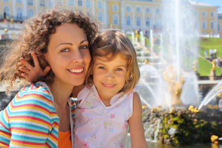 Daughter with mother  near fountains of Petergof, Saint Petersburg, Russia photo