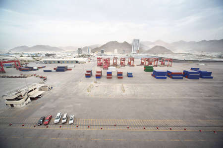 moorings: cars, many cargos, buildings and other constructions in port. Editorial