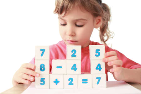 extremity: Little girl folds equalizations from cube