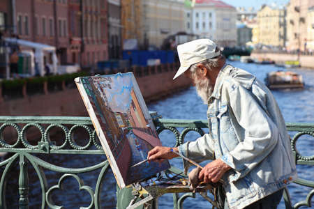 etude: SAINT-PETERSBURG - MAY 21: Craftsman paint on Nevskom prospectus, May 21, 2010, Saint-Petersburg, Russia. Saint-Petersburg has also been nicknamed  Venice of the North.