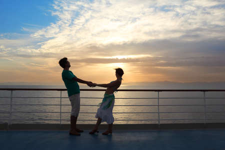 couple: man with woman on deck of cruise ship. sunset. photo