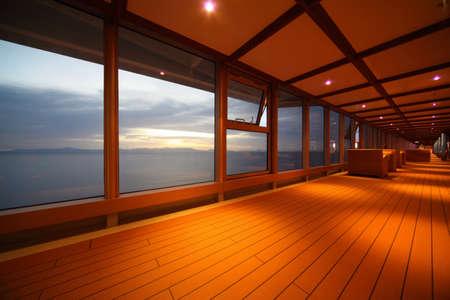 corridor on cruise ship. row of lamps. beautiful view  through window.