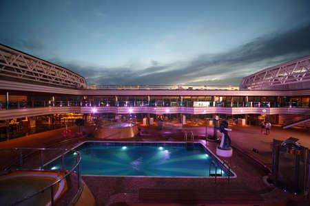 PERSIAN GULF - APRIL 14: Swimming pool on deck of Costa Deliziosa - the newest Costa cruise ship,  April 14, 2010 in Persian Gulf.