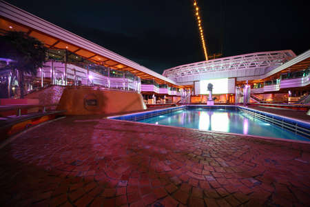 PERSIAN GULF - APRIL 14: Swimming pool in the deck of Costa Deliziosa - the newest Costa cruise ship, April 14, 2010 in Persian Gulf. Editorial