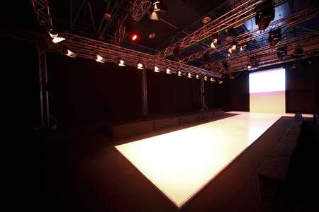 fashion model catwalk: Side view on  shone podium before  beginning of fashionable display