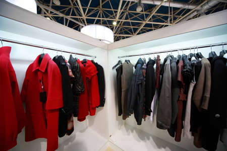 trade fair: Firm outer clothing hangs at demonstration stands in showroom