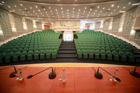 conventions: Interior and front entrance in  big conference room. Kind from  scene.