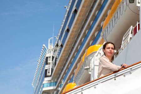 adult cruise: Girl on ladder goes to the ship and looks into the distance