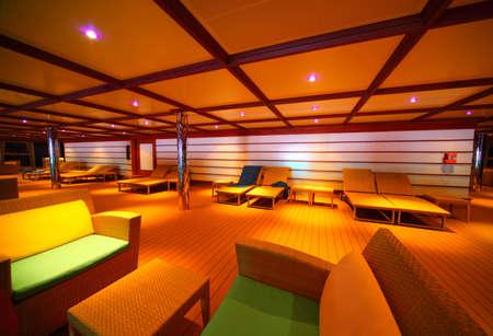 Interior of illuminated hall on the cruise ship deck at night