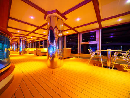 luxury liner: Interior of illuminated restaurant on the cruise ship deck at night