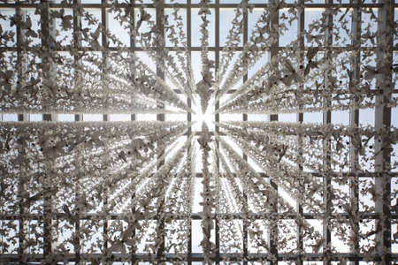 glass ceiling in public building decored with butterfly garlands, abstract background photo