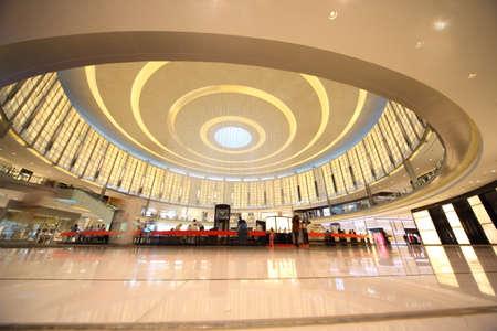 bright center: DUBAI, UAE - APRIL 14: Shoppers at Dubai Mall April 14, 2010 in Dubai, United Arab Emirates. Dubai Mall is one of the largest mall in the world.
