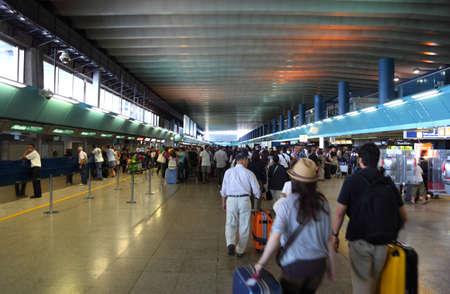 disembark: FIUMICINO, ITALY - AUGUST 6: Crowd people in passageway for registration inside Leonardo da Vinci-Fiumicino Airport - largest airport in Italy on August 6, 2010 in Fiumicino near Rome, Italy.