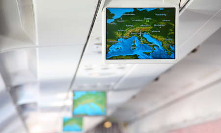 Lcd monitor showing a map of Europe inside salon of aircraft