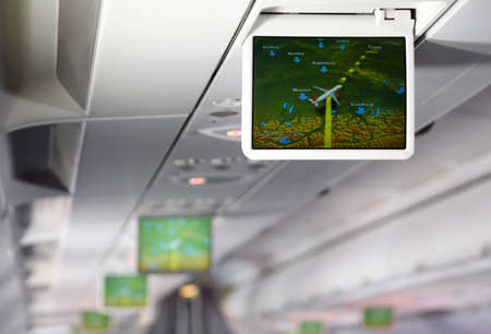 Lcd monitor showing aircraft traffic diagram of Europe inside salon of aircraft
