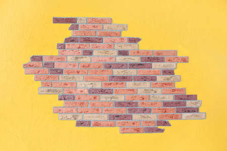 red brick wall and yellow plaster wall, bright interior photo