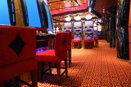 hall monitors: modern empty casino hall with game machines, side view Editorial