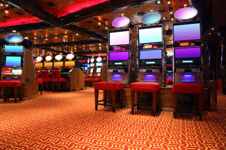 casino game: modern empty casino hall with game machines, general view