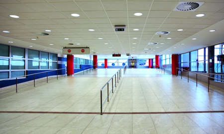 office ceiling: Walk with ladder grab in empty light hall inside airport at day