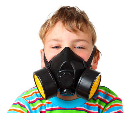 Little blonde boy screw up ones eyes in black respirator on a white background