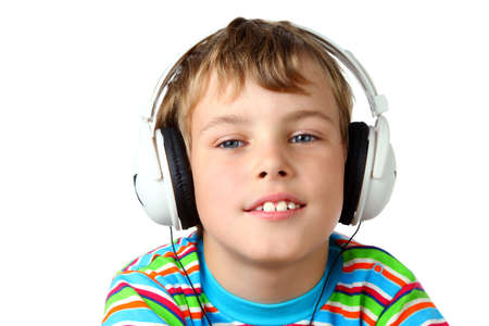 Little smiling boy in striped shirt and headphone listening to music  photo
