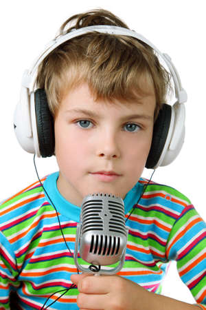 Little boy in striped shirt and headphone with microphone in hands  스톡 콘텐츠
