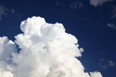 cloude: Big white massive cumulus clouds on background of pleasant blue color sky Stock Photo