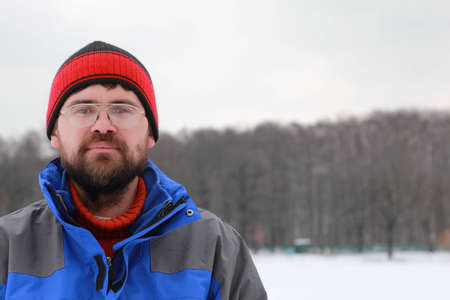 Portrait of man spectacled in winter photo