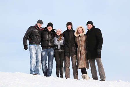young fellow: Group of students stand together on snow in winter Stock Photo