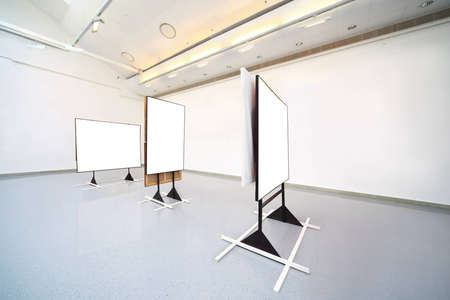Show-room with large pictures of white color photo