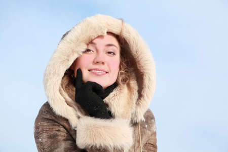 Portrait of girl which leans chin on hand in winter photo