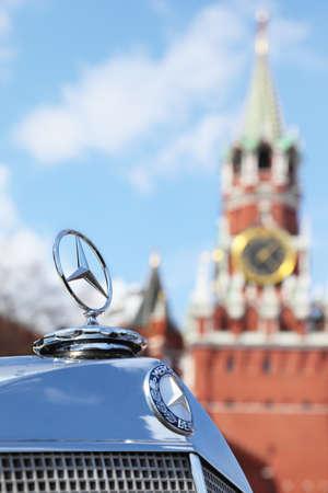 MOSCOW, RUSSIA - APRIL 24: Logotype of vintage Mercedes-Benz on Kremlin background  on Kremlin background on Vintage car rally