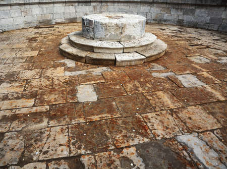 Inside stone drained fountain, which sprinkled with coins on place of execution of Red square in Moscow, Russia