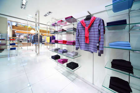 Masculine clothes are for sale in shop Stock Photo - 12512771