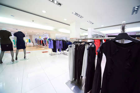 Large shop of womanish clothes, focus on peg on right in center Stock Photo - 12512753