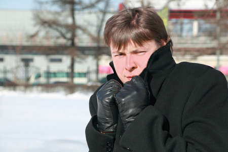 froze: Young man froze in winter and hides head in collar