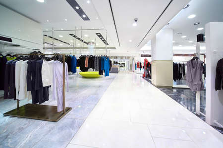 Stylish womanish clothes are for sale in large shop Editorial