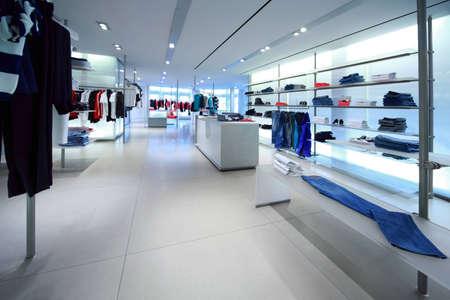 Clothes for men hang in shopping center Stock Photo - 12512667